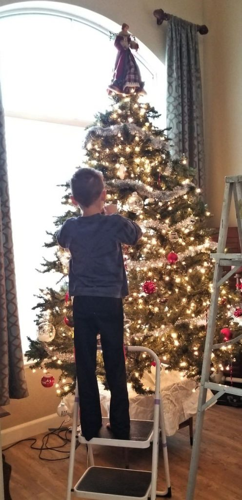 putting-ornaments-on-a-tree